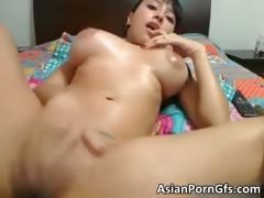 Busty oriental slut rubbing...